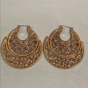 Large gold colored earrings